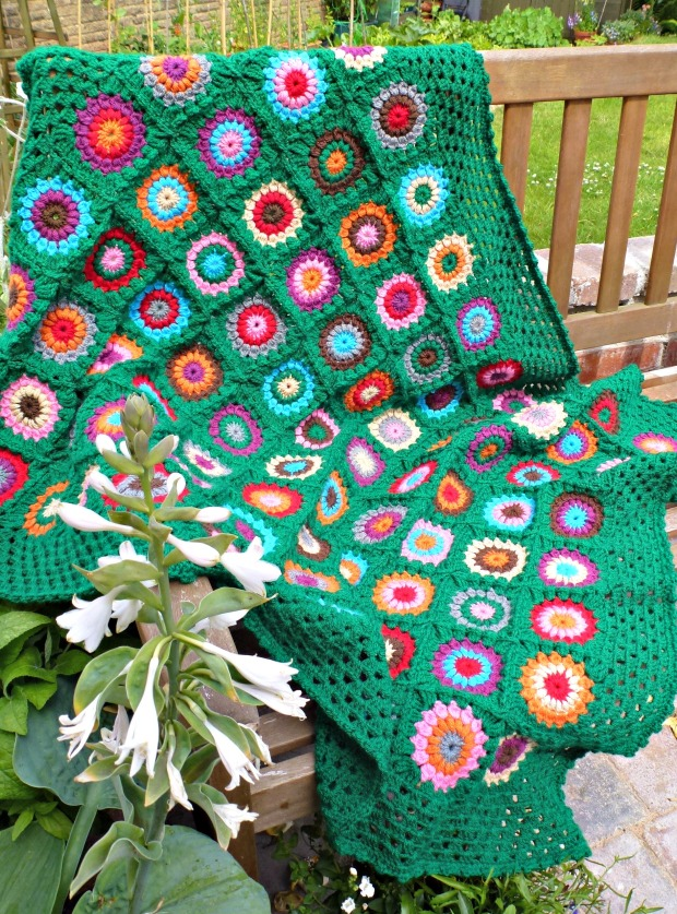 green blanket in garden