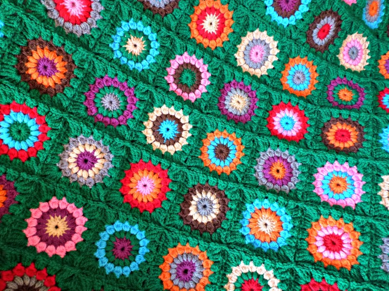 green crochet circle blanket