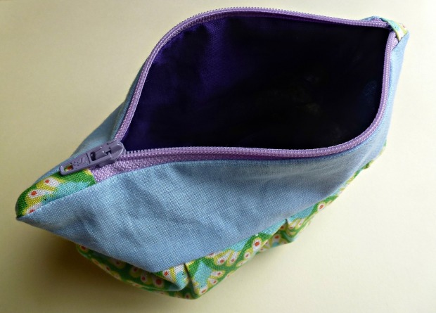 purple lining zipper purse