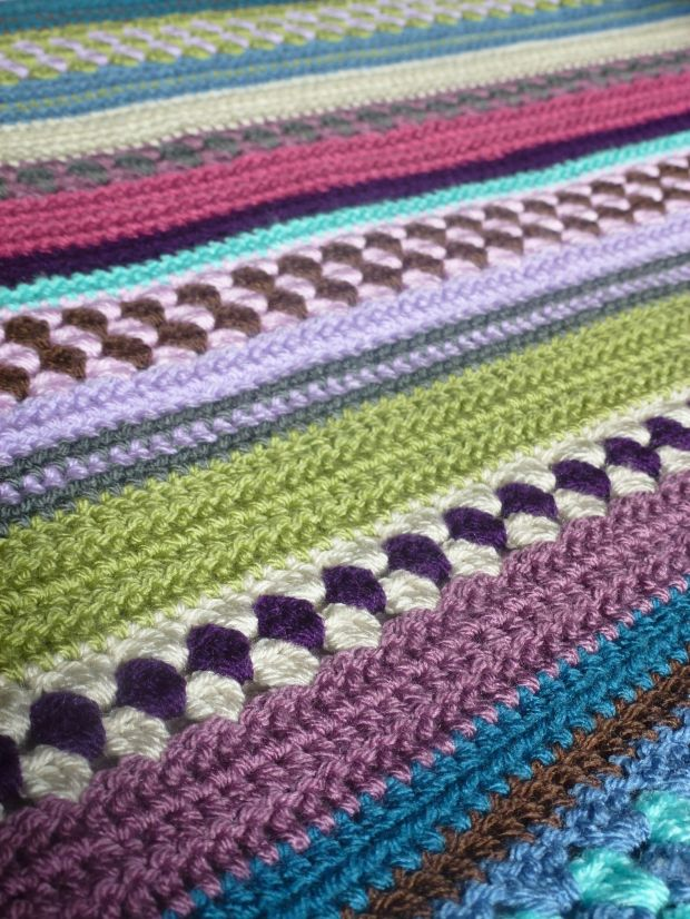 a mixed up granny stripe crochet blanket