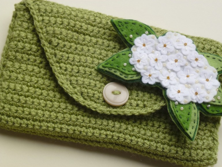 crochet purse with elderflower brooch