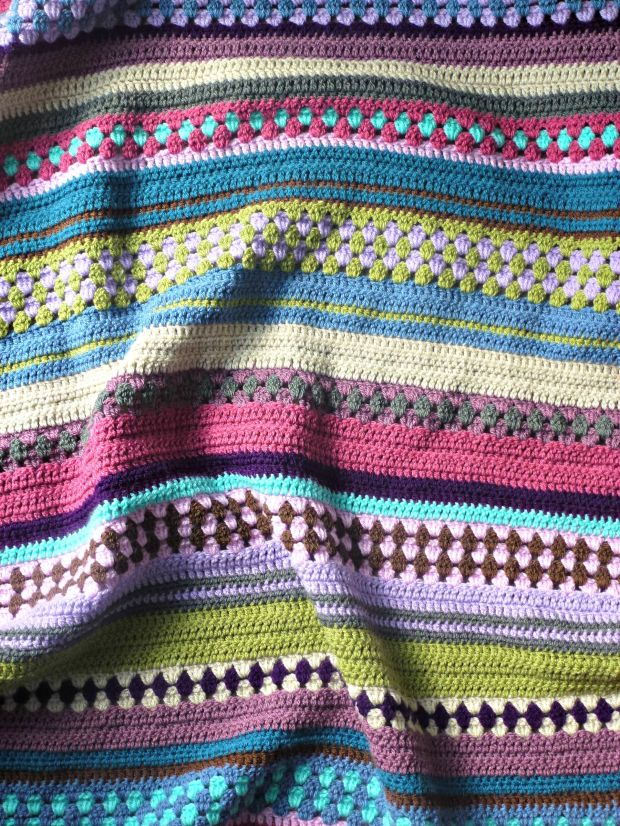 mixed up granny stripe crochet baby blanket.