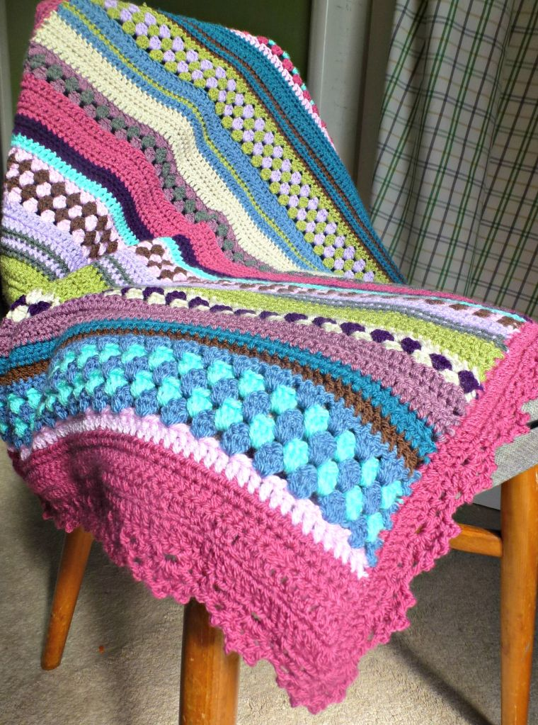 Mixed up granny stripe crochet blanket