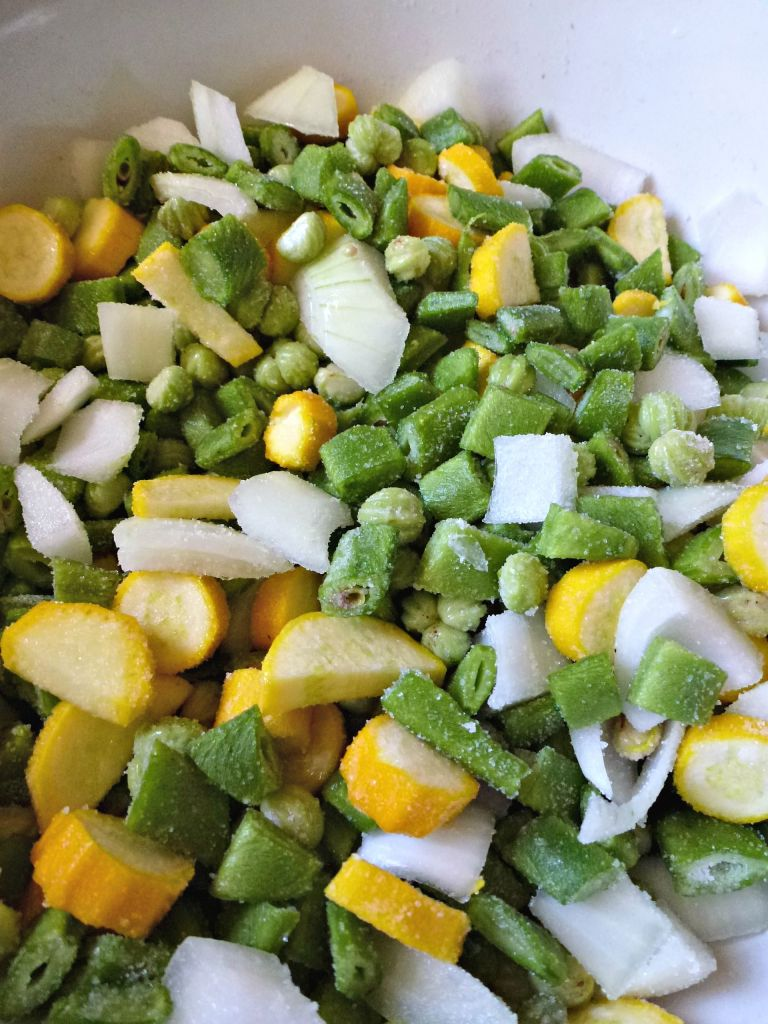 vegetables being salted for piccalilli.