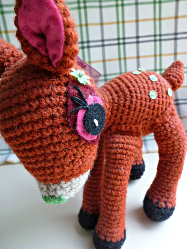 Amigurumi fawn. He's a few years old and looking dusty. Still love him.