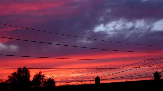 sun setting over houses