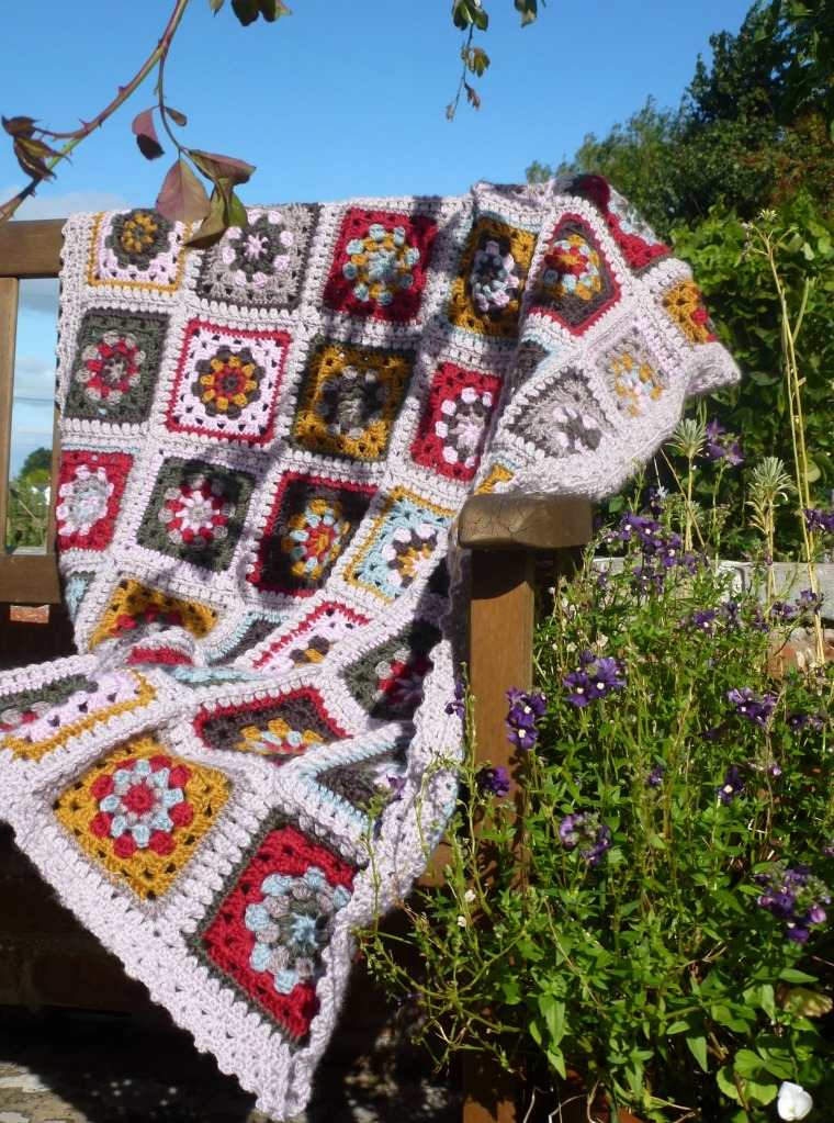 crochet blanket enjoying the autumn sunshine.