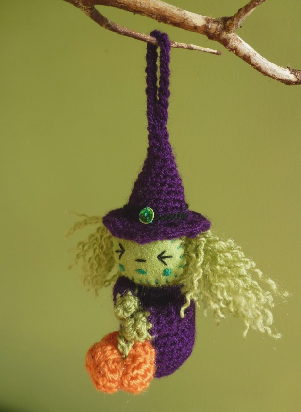 little purple amigurumi witch.