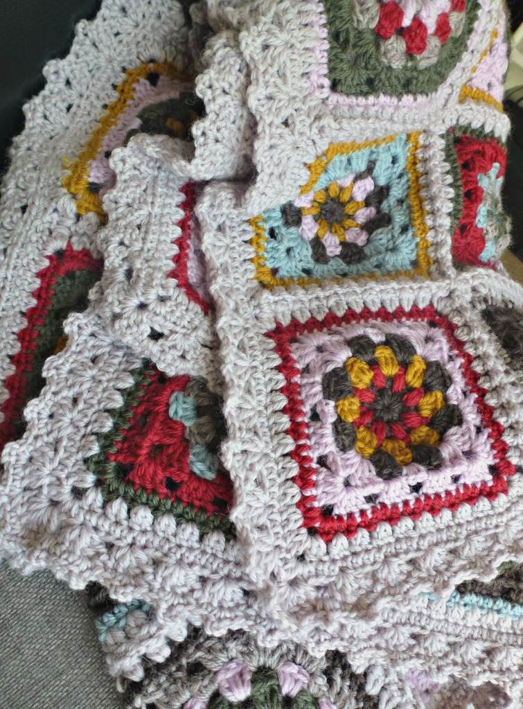 Love the crochetedging on this granny blanket