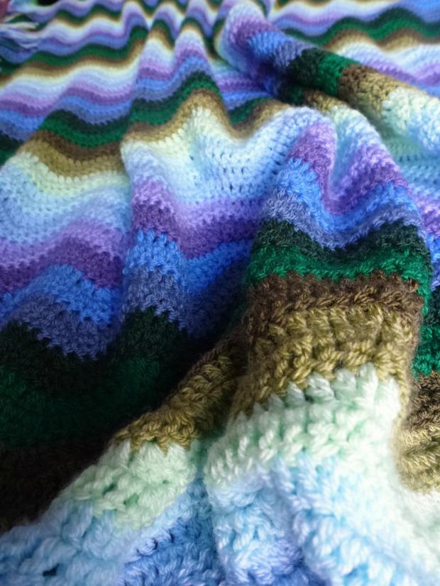 Single bed crochet ripple blanket.
