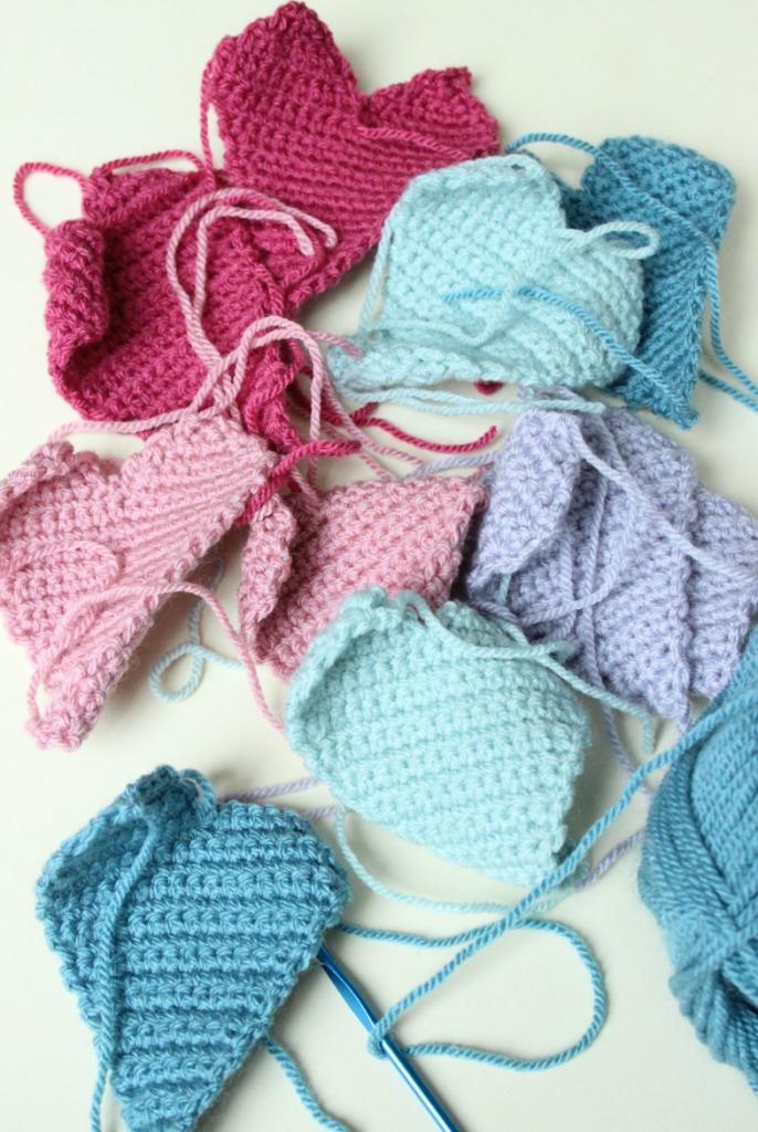 Making crochet hearts.