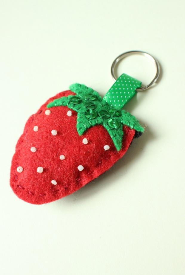 A felt strawberry keyring.