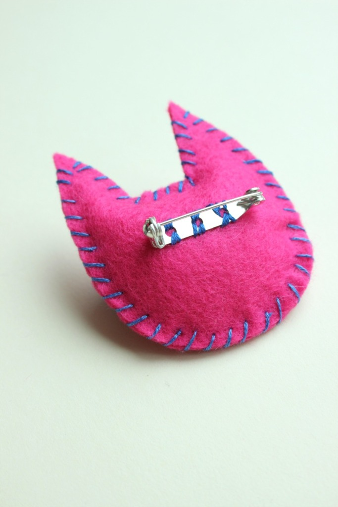 back of pink kitty brooch.