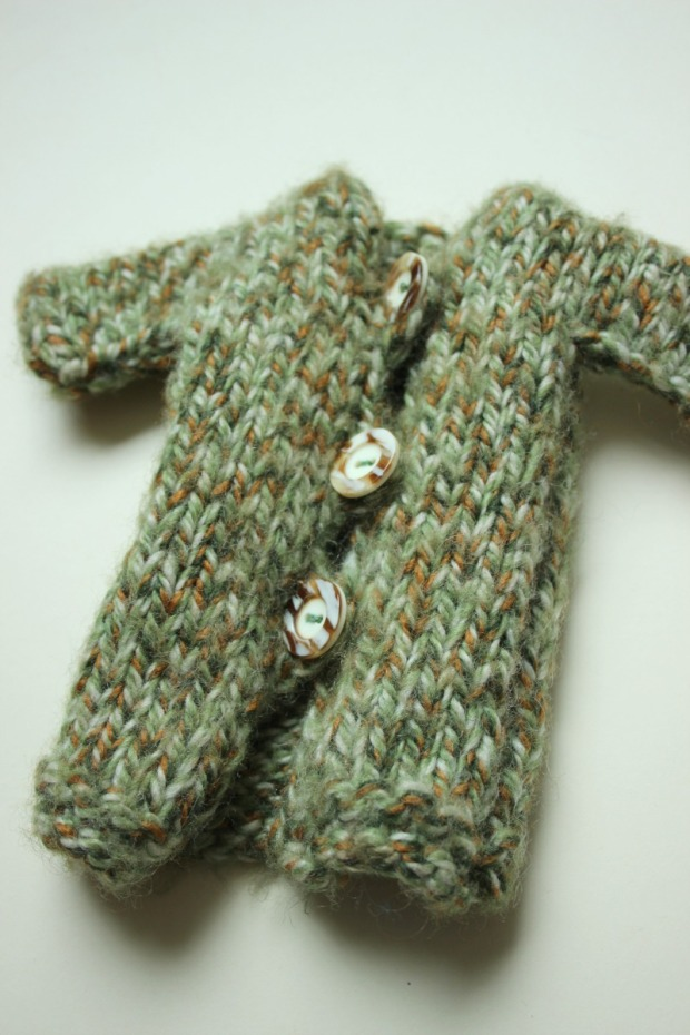 hand knitted dolls coat.