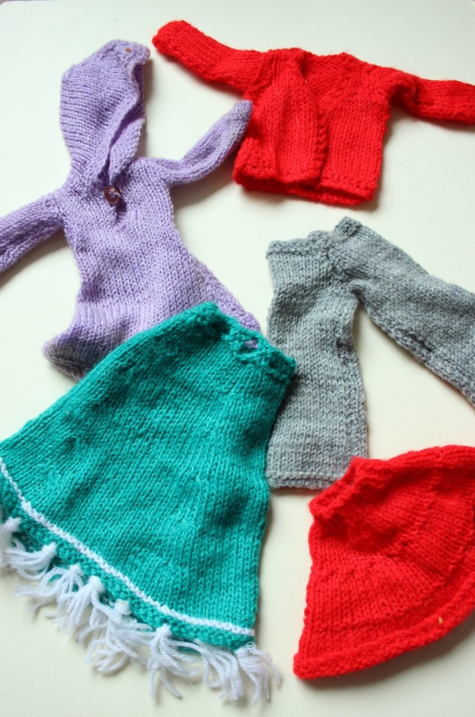 Handknitted dolls clothes.